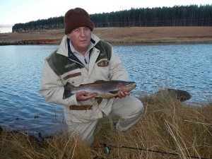 Alan with a nice rainbow from a club water
