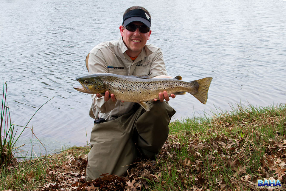 Warren with a brown trout caught during the festival